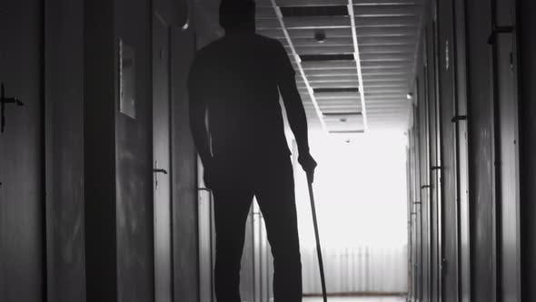 Thumbnail for Silhouette of Limping Man Walking