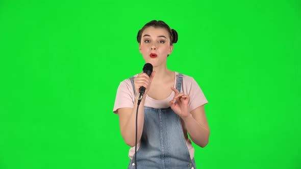 Thumbnail for Attractive Girl Sings Into a Microphone and Moves To the Beat of Music
