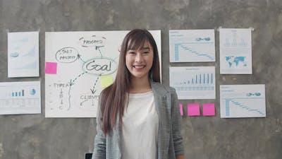 beautiful executive businesswoman smart casual wear looking at camera.