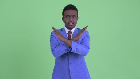 Cover Image for Serious Young African Businessman with Stop Gesture