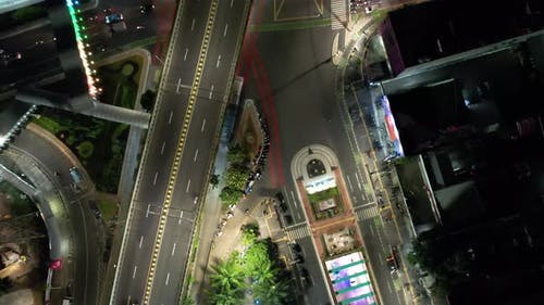 Aerial view of the city traffics at the Senen cross down at night.