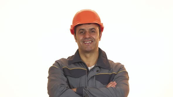 Cover Image for Cheerful Mature Constructionist in Hardhat Showing Thumbs Up