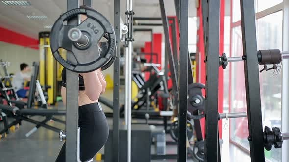 Thumbnail for Young Woman With Beautiful Sportive Body Fails to Raise Heavy Dumbbell in Gym