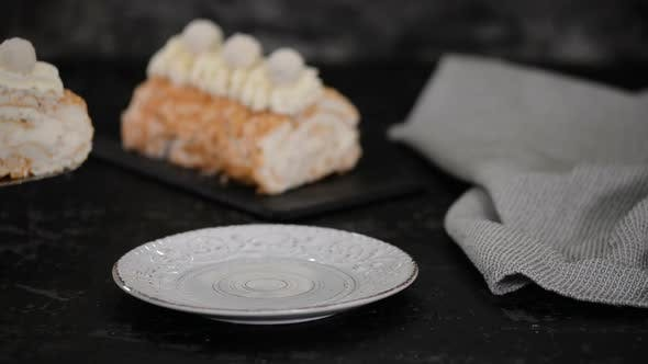 Thumbnail for Delicious Meringue Cake Roll Slice On A Plate.