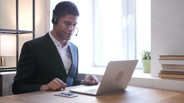 Black Businessman Attending Customer Call, Call Center