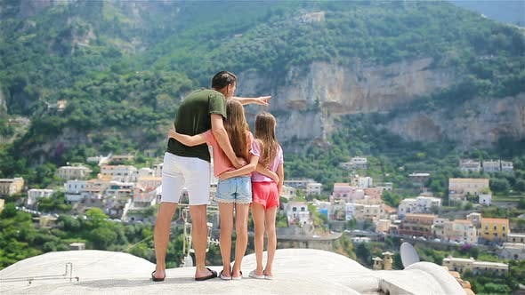 Father and Kids Taking Selfie Photo Background Positano Town in Itali on Amalfi Coast
