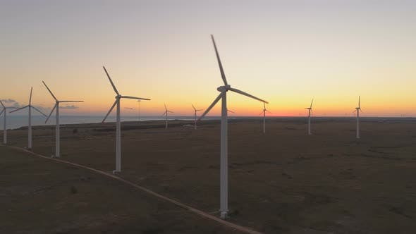 Thumbnail for Wind Turbines at Wind Farm Generating Renewable Energy at Sunset