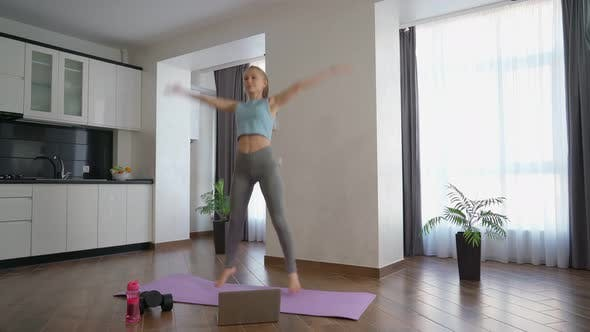 Woman Doing Fitness Exercises on Yoga Mat