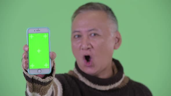 Thumbnail for Face of Happy Mature Japanese Man Showing Phone