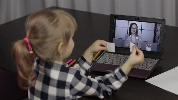 Thumbnail for Children Distance Education on Laptop. Online Lesson at Home with Woman Teacher
