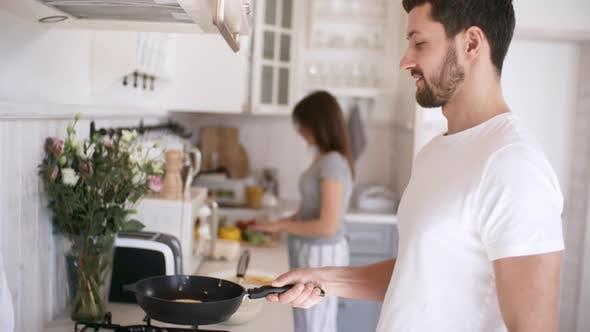 Thumbnail for Man Tossing Pancake and Looking at Camera