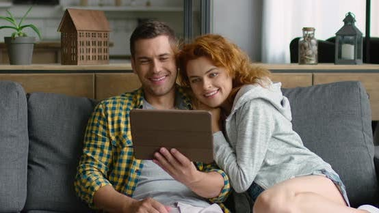 Thumbnail for Young Man and Woman Have a Video Chat on Tablet Computer