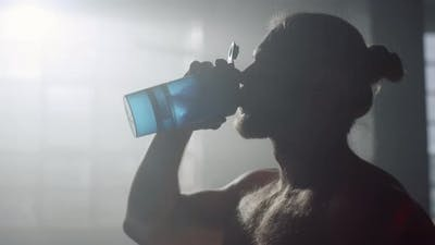 Man Drinking Water After Training
