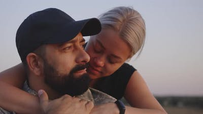 Wife Hugging Wheelchaired Husband