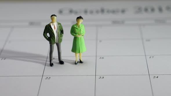 Couple Figurines on a Calendar.