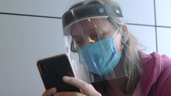 Thumbnail for Adult Woman in Medical Mask and Face Shield in Airport