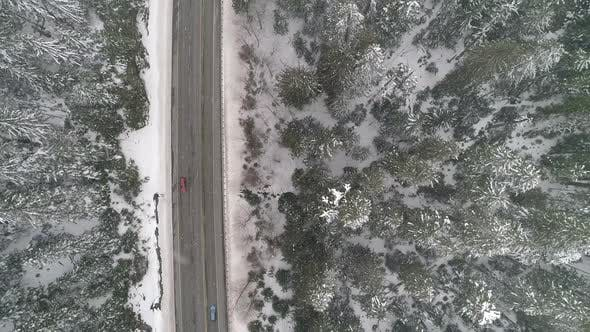 Thumbnail for Winter Snow Falling Mountain Highway Birdseye Aerial