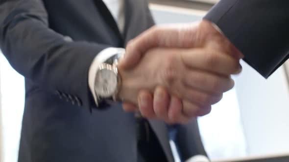 Thumbnail for Closeup of Businessman Giving Handshake