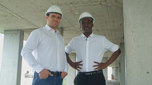 Thumbnail for Architectural team smiling at the camera with hard hats
