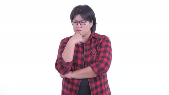 Thumbnail for Stressed Overweight Asian Hipster Woman Thinking