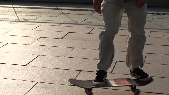 Thumbnail for Feet of Man Skater Making Ollie Trick From Bank