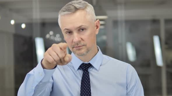 Thumbnail for Grey Hair Businessman Pointing Toward Camera
