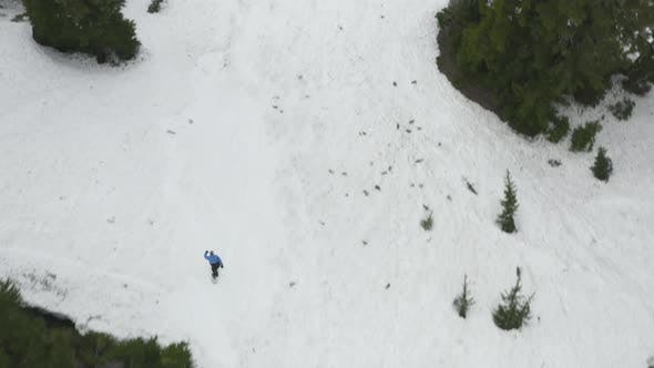 Thumbnail for One Person Snowboarding Jumping Off Extreme Terrain Aerial Shot High Above Rider