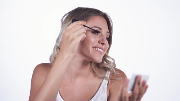 Thumbnail for Pretty Woman Applying Black Mascara