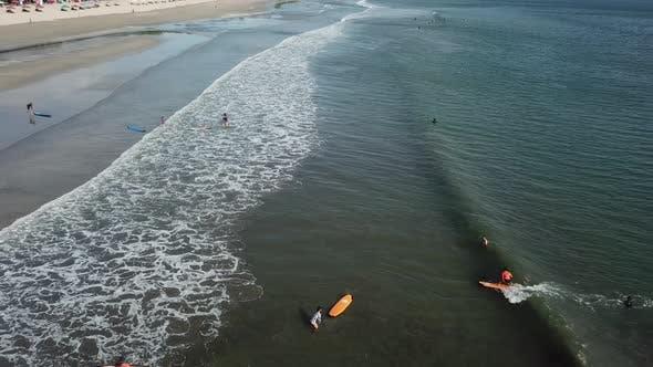 Surfers Ride in the Sea