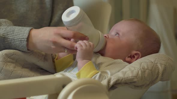 Thumbnail for Baby Eats From A Bottle