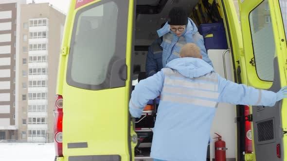 Thumbnail for Team of Paramedics Jumping out of Ambulance