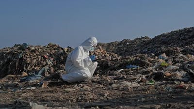 scientist checking waste will be dumped