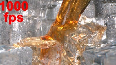 Brandy Whisky Splashing On Ice In A Glass In Slow Motion