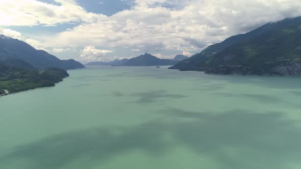 Thumbnail for Aerial Ocean Pan To Turquoise Water And Islands Of Thick Forest Mountains On Howe Sound