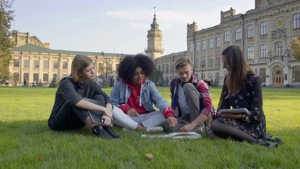 Thumbnail for Students Sitting on the Grass  at the University or College Campus