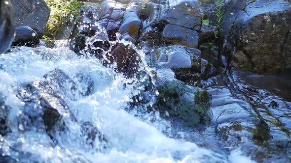 Thumbnail for Small Rapids With Fast Moving Water Running Beside Rocks 2