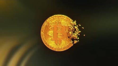 A Bitcoin coin breaks into parts
