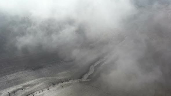 Thumbnail for Flight Over A Dry Dam In The Autumn Foggy Day In The Morning