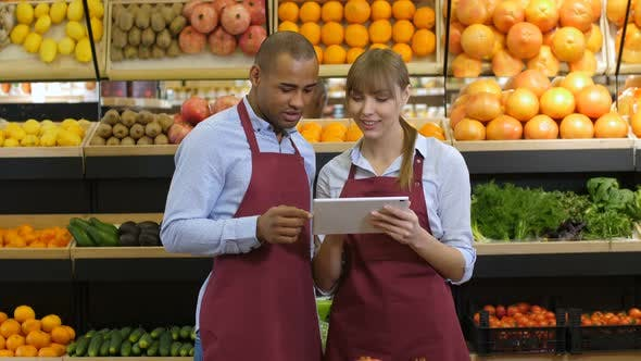 Cover Image for Grocery Store Owners Ordering Products Using Tablet