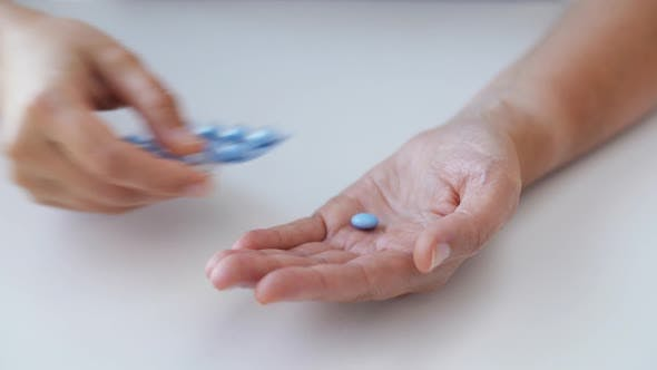 Thumbnail for Woman Hands Opening Pack of Medicine Pills