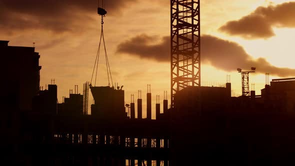 Cover Image for Silhouette of Crane Working on Construction Site Elevate Concrete Mixer, Sunny Evening, Golden Hour
