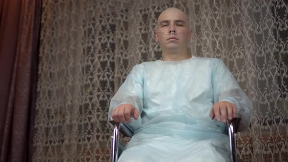 Thumbnail for A Bald Young Man with Cancer Looks at the Camera and Prays. The Patient Folded His Arms and Prayed