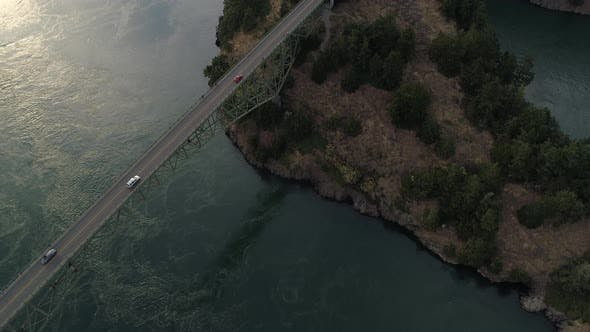 Thumbnail for Epic Aerial With Slow Pan From Forest Trees To Big Bridge Crossing Ocean Islands