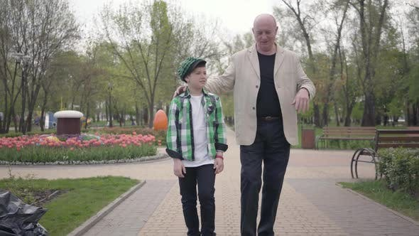 Thumbnail for Portrait Cute Grandfather and Adorable Grandson Walking To Camera in the Park