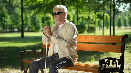 Depressed Blind Man Sitting Alone in Park, Socially Disadvantaged Population