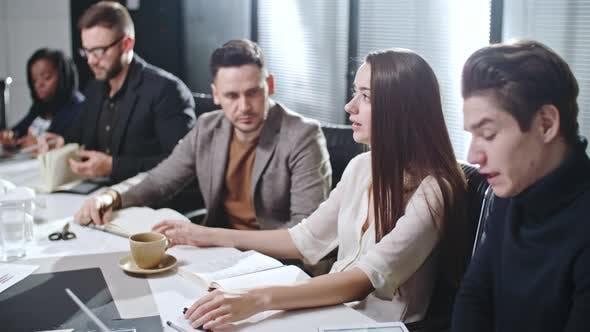 Coworkers in Meeting Room