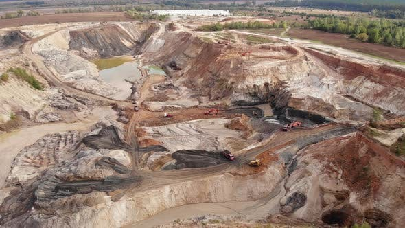 Thumbnail for Extraction of iron ore, copper, gypsum. Opencast mining quarry with lots of machinery trucks