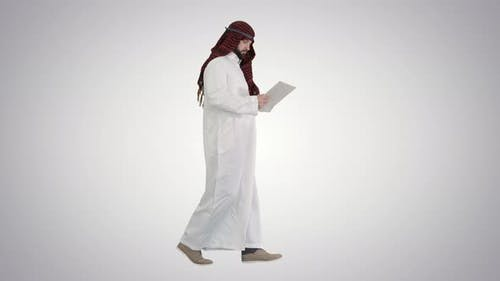 Sheikh Using Digital Tablet and Walking on Gradient Background