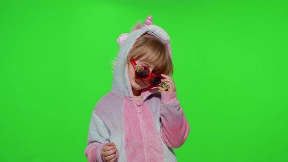Thumbnail for Little Child Girl Smiling Dancing Winking Celebrating in Unicorn Pajamas Costume on Chroma Key
