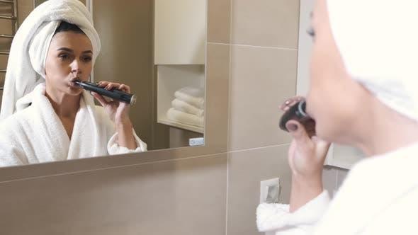 Woman Robe Towel Brushing Teeth Bathroom